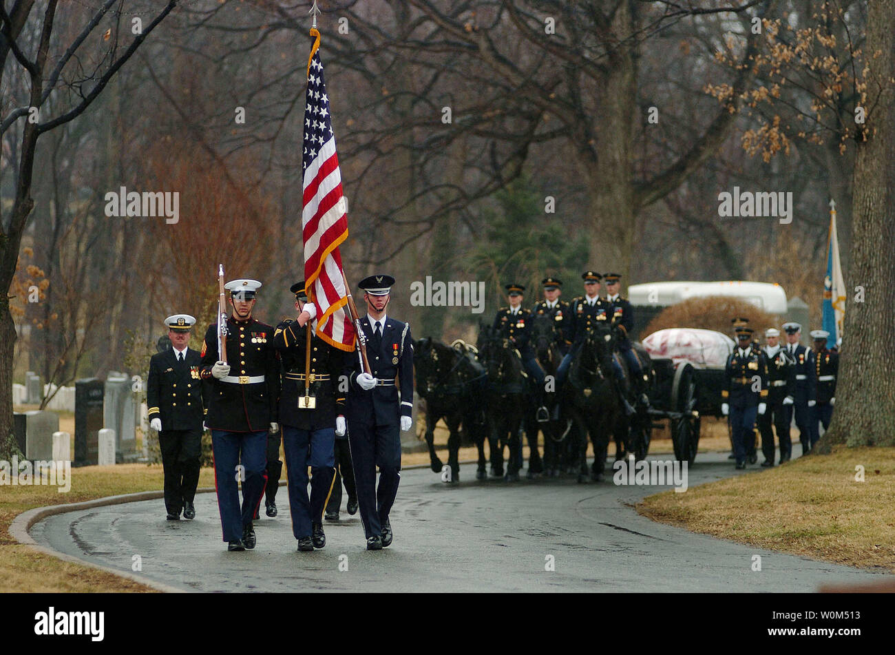 Members of the U.S. Army's 3rd Infantry 'Old Guard' caisson platoon, parade the black flag draped casket of Adm. Thomas H. Moorer, during a full military honors burial at Arlington National Cemetery on February 20, 2004. Adm. Moorer is a graduate of the Naval Academy class of1933 and went on to served as the Chief of Naval Operations from 1967-1970, whereupon he was appointed Chairman of the Joint Chiefs of Staff, a post he held until his retirement in 1974. A former naval aviator, Moorer earned many medals and honors during his career, including the Department of Defense Distinguished Service - Stock Image