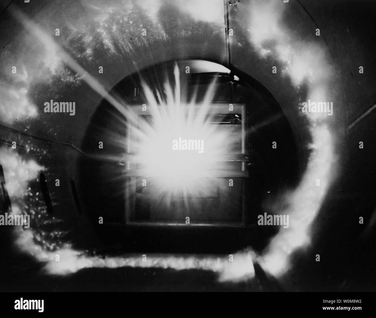 The photo, taken on Jan. 1, 1963, shows the 'energy flash' that occurs when a projectile launched at speeds up to 17,000 miles an hour impacts a solid surface at the Hypervelocity Ballistic Range at NASA's Ames Research Center. This test was used to simulate what happens when a piece of orbital debris hits a spacecraft in orbit. (UPI Photo/NASA) - Stock Image