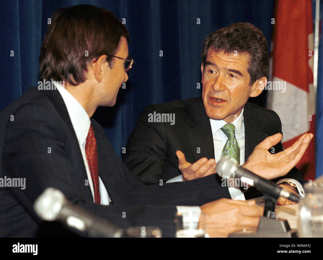 CEO of BP Lord John Browne (R), pictured in a June 13, 2000 file photo in Calgary, resigned after a judge allowed a newspaper to publish allegations that Browne misused company resources in London on May 2, 2007.  (UPI Photo/Heinz Ruckemann/FILES) - Stock Image