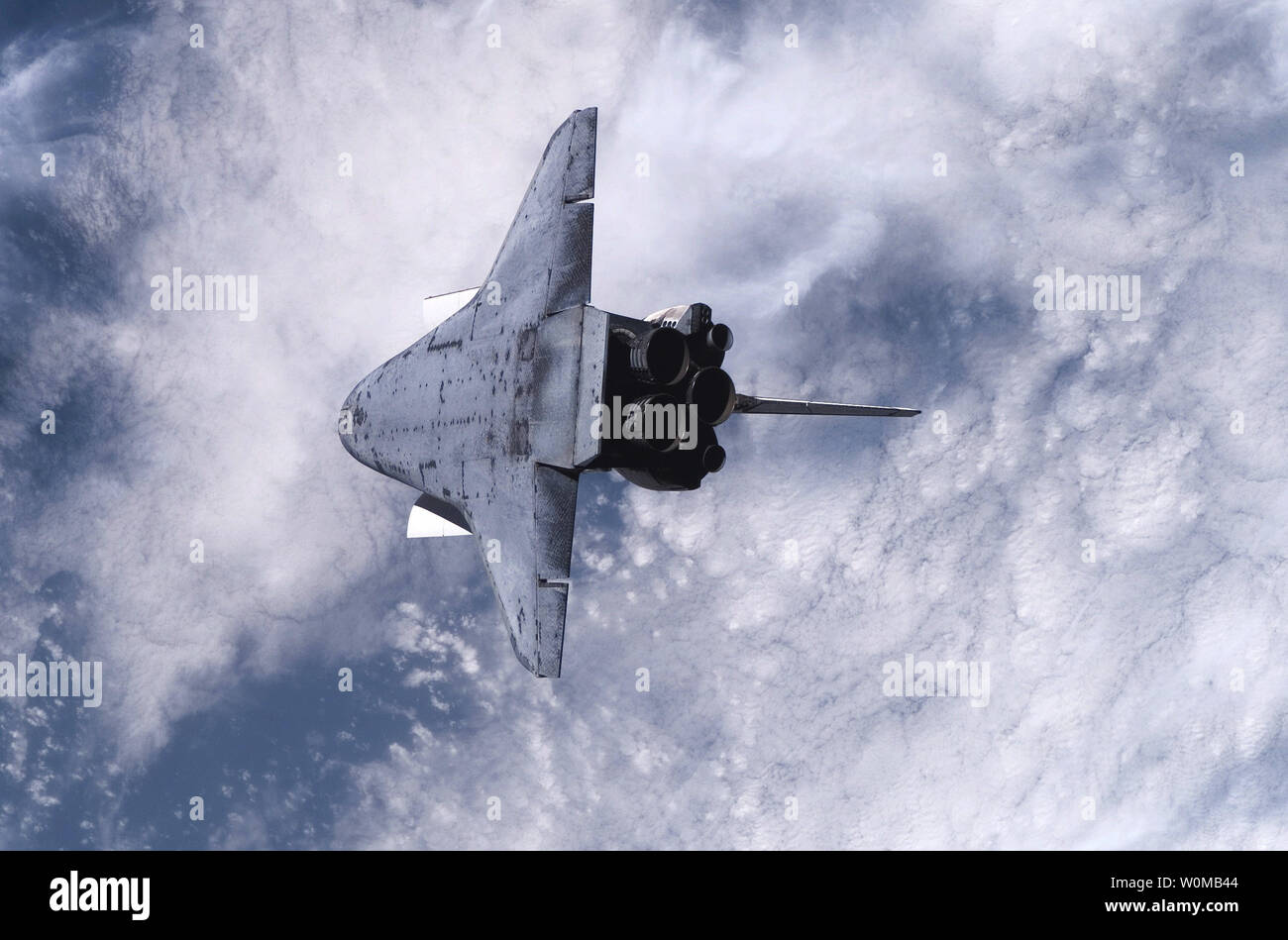 This NASA photo taken by Astronauts onboard the International Space Station on August 10, 2007 shows the underside of the Space Shuttle Endeavour during a back flip and careful survey by crew members onboard the orbital outpost. After ground studies, mission managers suspect debris came off Endeavour's external fuel tank one minute after liftoff on Wednesday and struck tiles on the shuttle's underside, near the right main landing gear door. (UPI Photo/NASA) - Stock Image