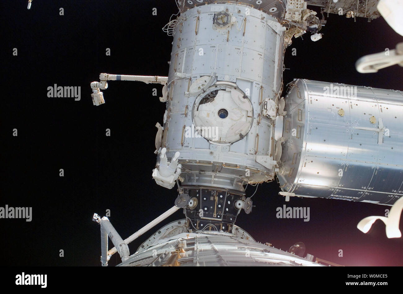 Mission Specialist Ron Garan, participates in the first scheduled session of extravehicular activity on the STS-124 mission of the space shuttle Discovery at the International Space Station on June 3, 2008. During the six-hour, 48-minute spacewalk, Garan and astronaut Mike Fossum (out of frame), loosened restraints holding the Orbiter Boom Sensor System in its temporary stowage location on the space station's starboard truss, prepared the Kibo Japanese Pressurized Module for its installation to the space station, demonstrated cleaning techniques for the Solar Alpha Rotary Joint's race ring and - Stock Image