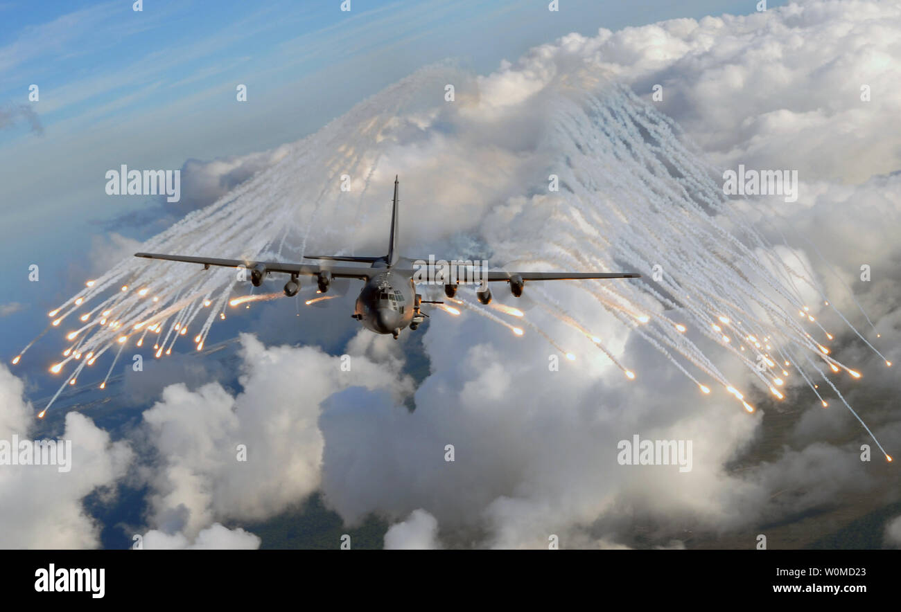 An AC-130H/U Gunship aircraft from the 4th Special Operation Squadron jettisons flares over an area near Hurlburt Field, Florida on August 20, 2008.  The flares are used as a countermeasure to heat-seeking missiles that can track aircraft during real-world missions.  (UPI PhotoJulianne Showalter/U.S. Air Force) - Stock Image