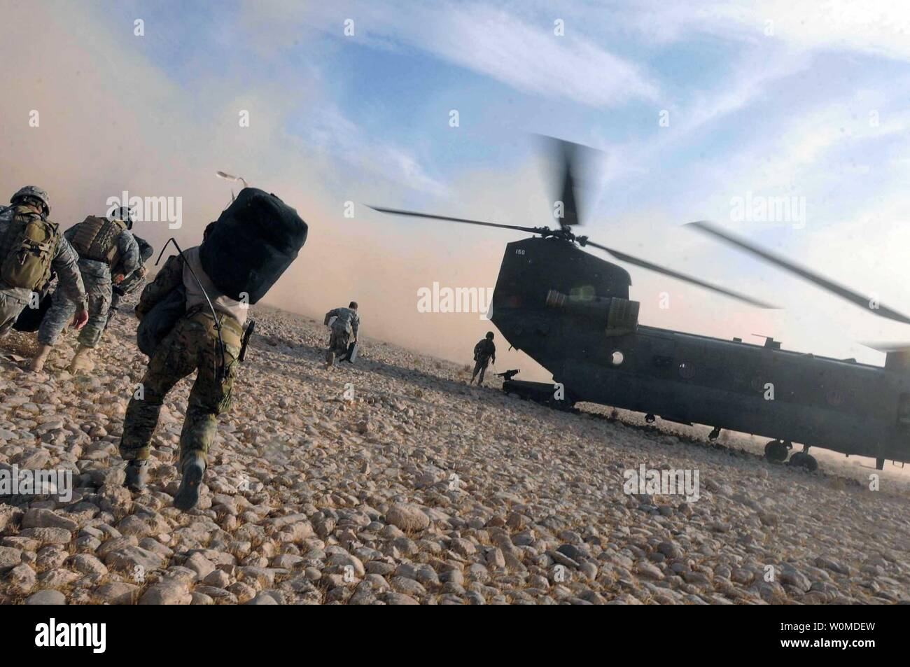 Service members load onto a U.S. Army CH-47 Chinook helicopter, a part of Task Force Eagle Assault, after it lands at a base in southern Afghanistan on November 29, 2008. (UPI Photo/Paul David Ondik/U.S. Army) Stock Photo