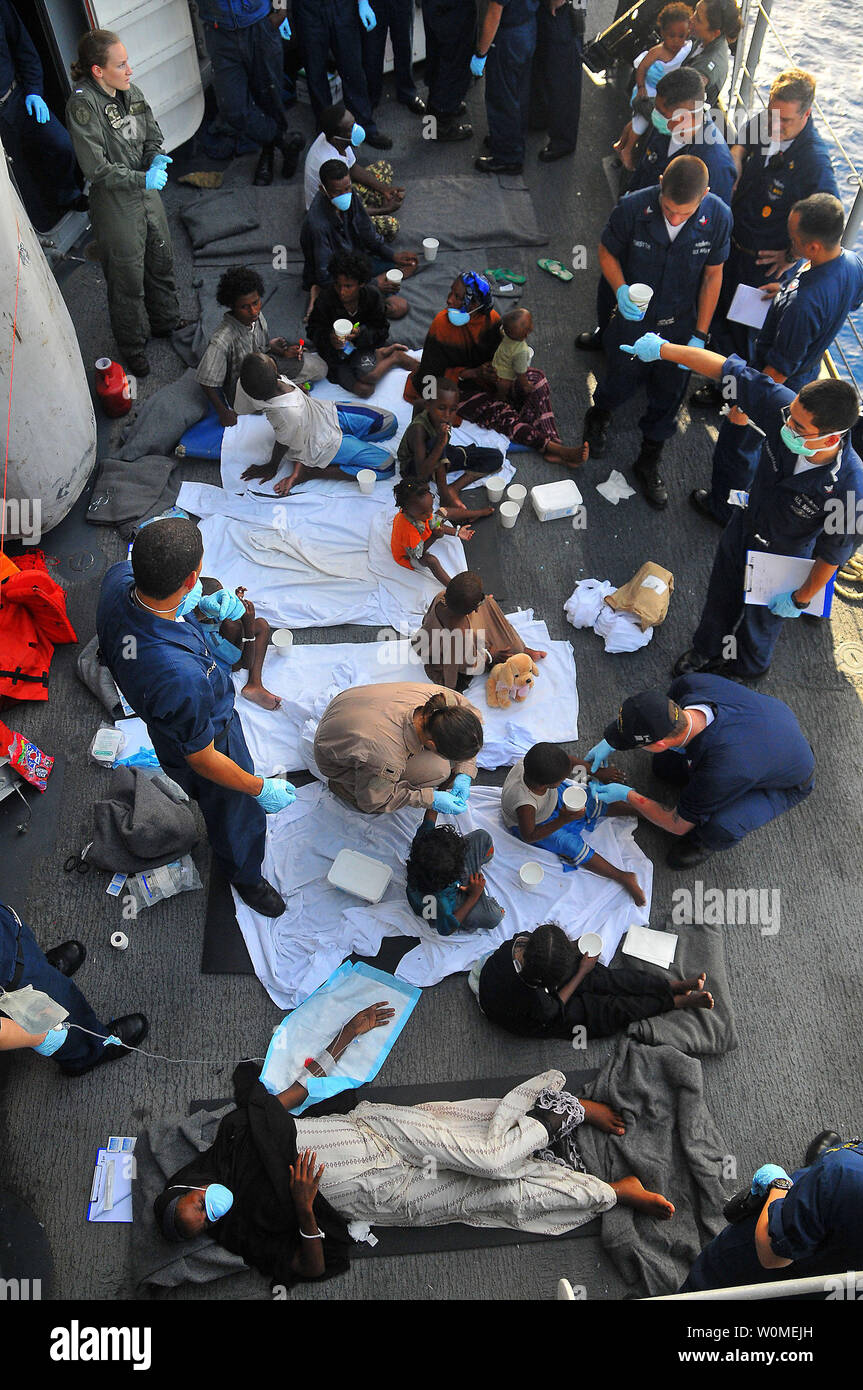 Somali migrants, including a nine-month pregnant woman, are treated aboard the guided-missile cruiser USS Lake Champlain (CG 57), after being rescued from a disabled skiff in the Gulf of Aden on May 24, 2009. The skiff, originally ferrying 52 passengers, was spotted in distress by Lake Champlain helicopter pilots while patrolling the area.  (UPI Photo/Daniel Barker/U.S. Navy) Stock Photo