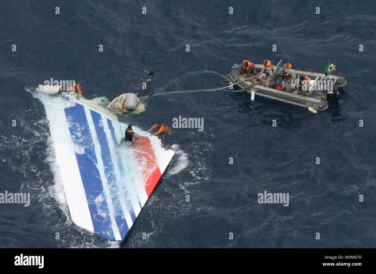 In this photo released by the Brazilian Air Force members of Brazil's Navy recover debris from the missing Air France jet in the Atlantic Ocean, June 8, 2009. The U.S. Navy is sending a team equipped with underwater listening devices to assist in the search for the missing black box. (UPI Photo/Brazilian Air Force ) - Stock Image