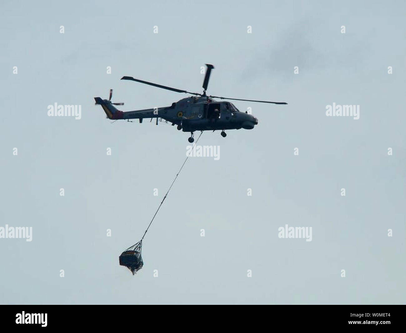 This photo released by the Brazilian Air Force on June 7, 2009 shows a helicopter lifting debris recover from the missing Air France jet out of the Atlantic Ocean, June 8, 2009. The U.S. Navy is sending a team equipped with underwater listening devices to assist in the search for the missing black box. (UPI Photo/Brazilian Air Force) - Stock Image