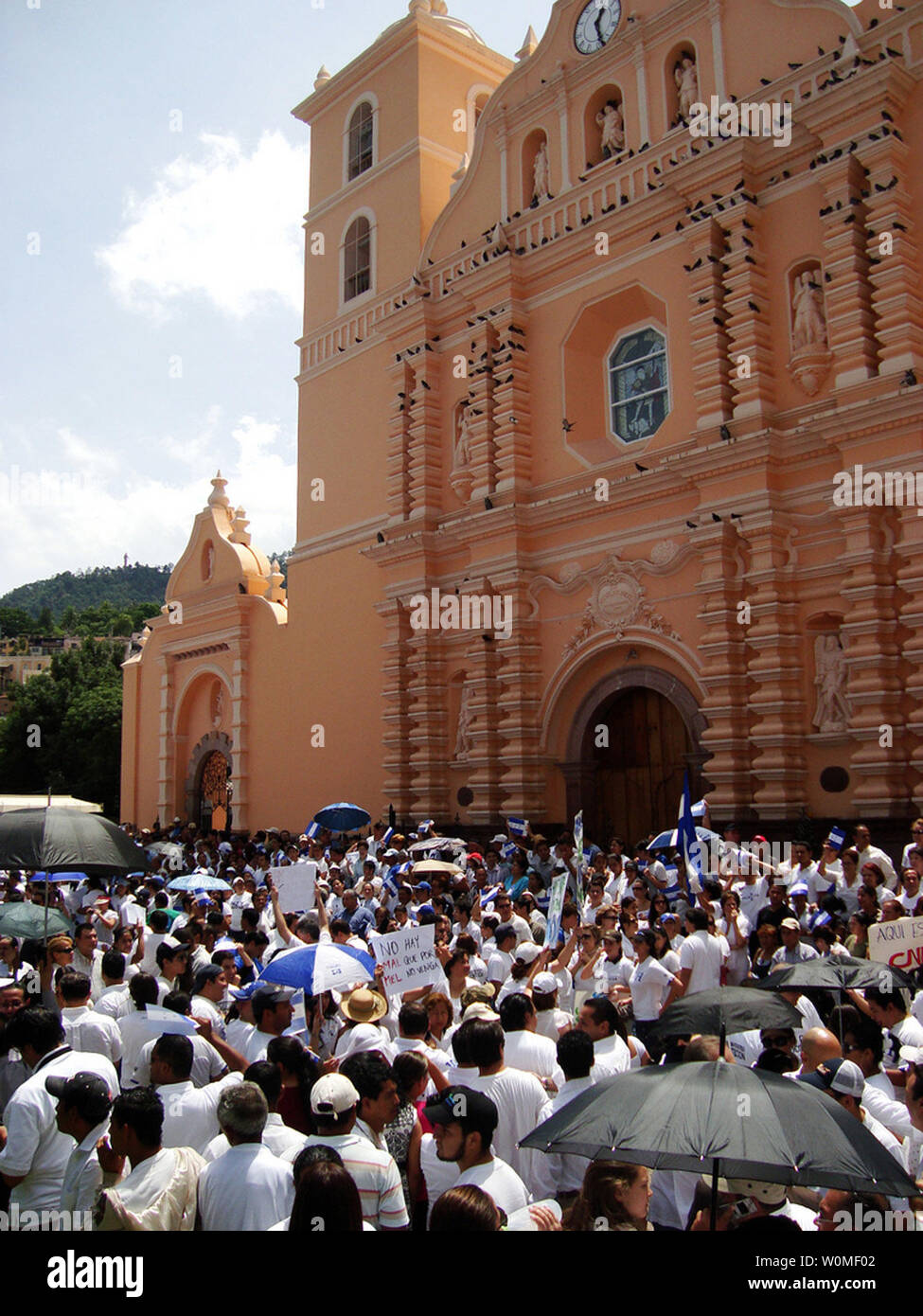 Hondurans participate in a rally against the return of ousted Honduran President Manuel Zelaya during a rally at the central park in Tegucigalpa, Tuesday June 30, 2009. (UPI Photo/Ek Balam) Stock Photo