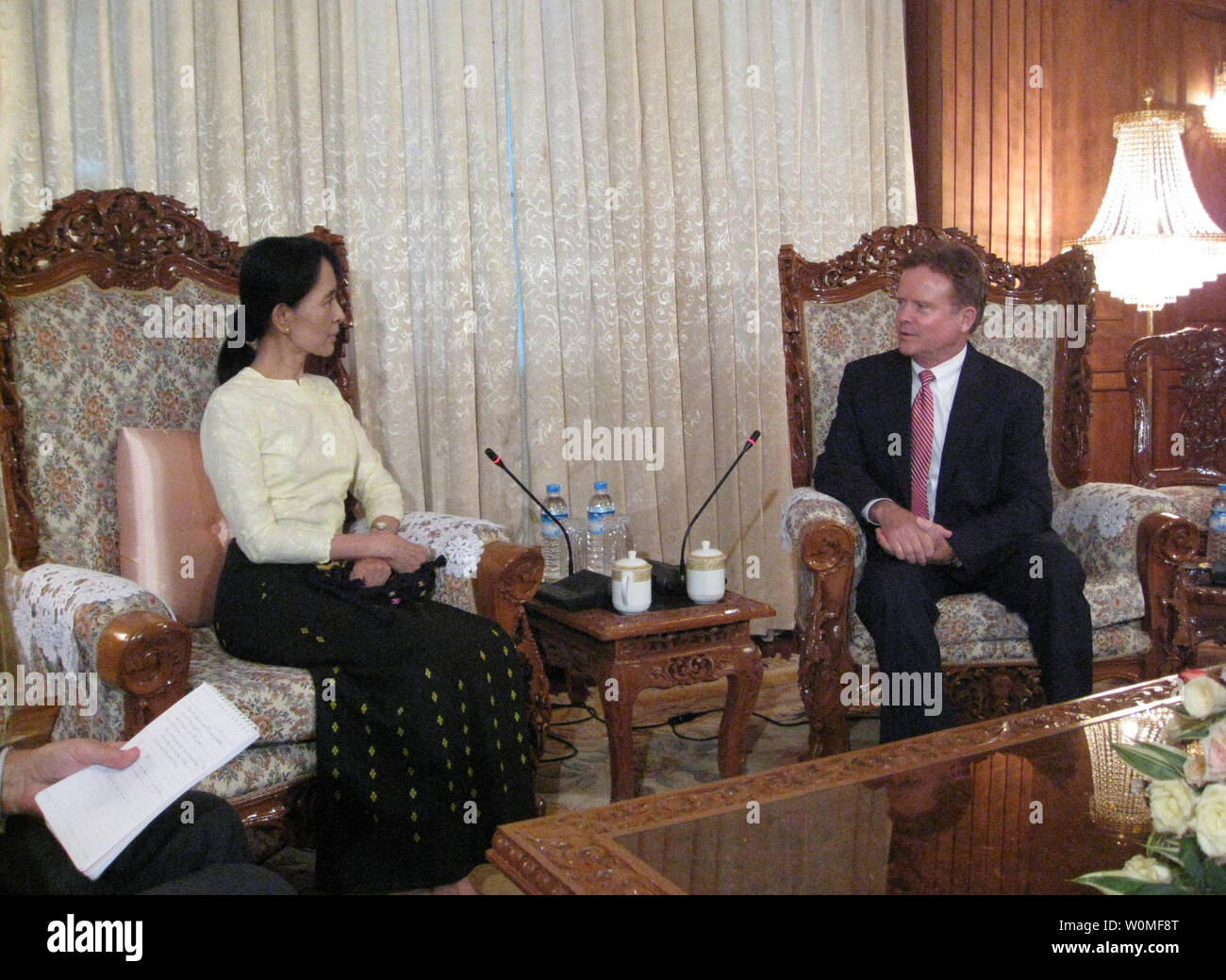 U.S. Sen. Jim Webb (D-VA) (R) meets with opposition leader Aung San Suu Kyi in Yangon, Myanmar on August 15, 2009. Suu Kyi has been detained for 14 of the past 20 years and was convicted of violating the terms of her house arrest by allowing American John Yettaw to stay at her home for two days. After Sen. Webb's visit, the generals of Myanmar agreed to release Yettaw, who was sentenced to seven years of hard labor. UPI/Sen. Webb's office - Stock Image
