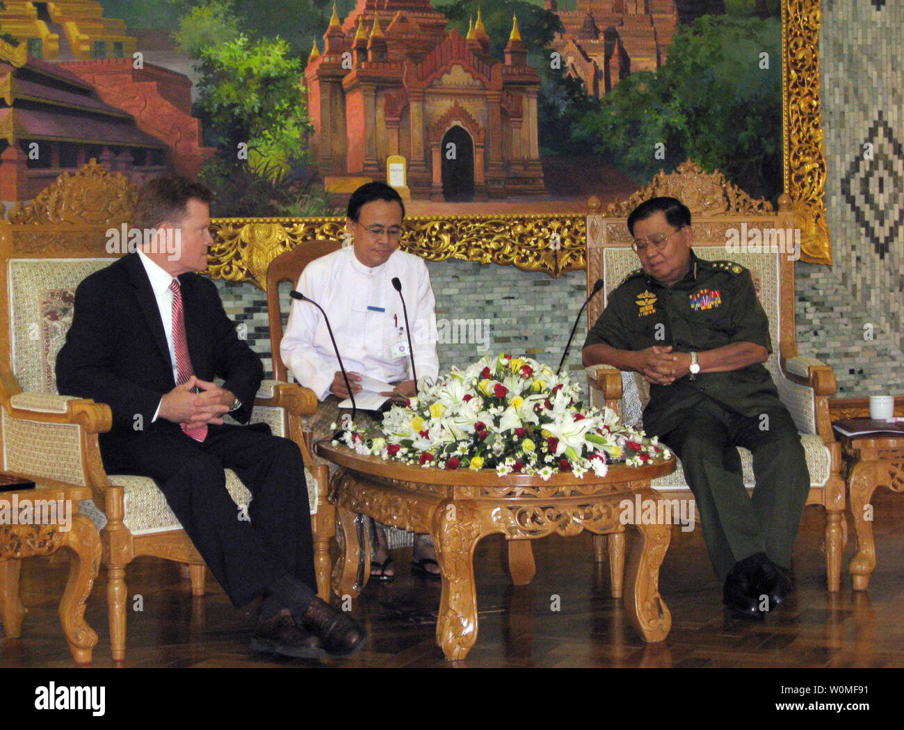 U.S. Sen. Jim Webb (D-VA) (L) meets with Myanmar's leader General Than Shwe in Yangon, Myanmar on August 15, 2009. Webb also met with opposition leader Aung San Suu Kyi, who has been detained for 14 of the past 20 years and was convicted of violating the terms of her house arrest by allowing American John Yettaw to stay at her home for two days. After Sen. Webb's visit, the generals of Myanmar agreed to release Yettaw, who was sentenced to seven years of hard labor. UPI/Sen. Webb's office - Stock Image