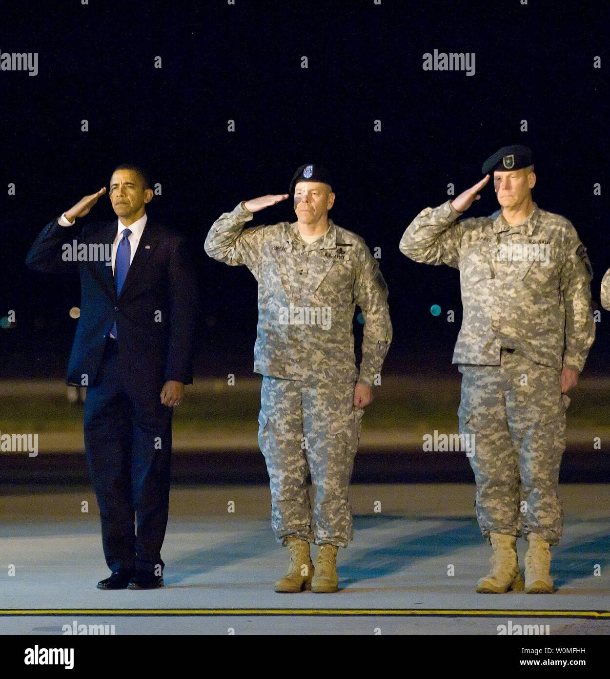 President Barack Obama, Army Maj. Gen. Daniel V. Wright, and Army Brig. Gen. Michael S. Repass render honors during as a team of Soldiers carry the remains of Sgt. Dale R. Griffin during a dignified transfer ceremony at Dover Air Force Base, Delaware on October 29, 2009. Griffin, who was assigned to 1st Battalion, 17th Infantry Regiment, 5th Stryker Brigade Combat Team, 2nd Infantry Division, was killed in action on October 27, 2009, by a roadside bomb in the Kandahar province of Afghanistan. UPI/Jason Minto/U.S. Air Force Stock Photo