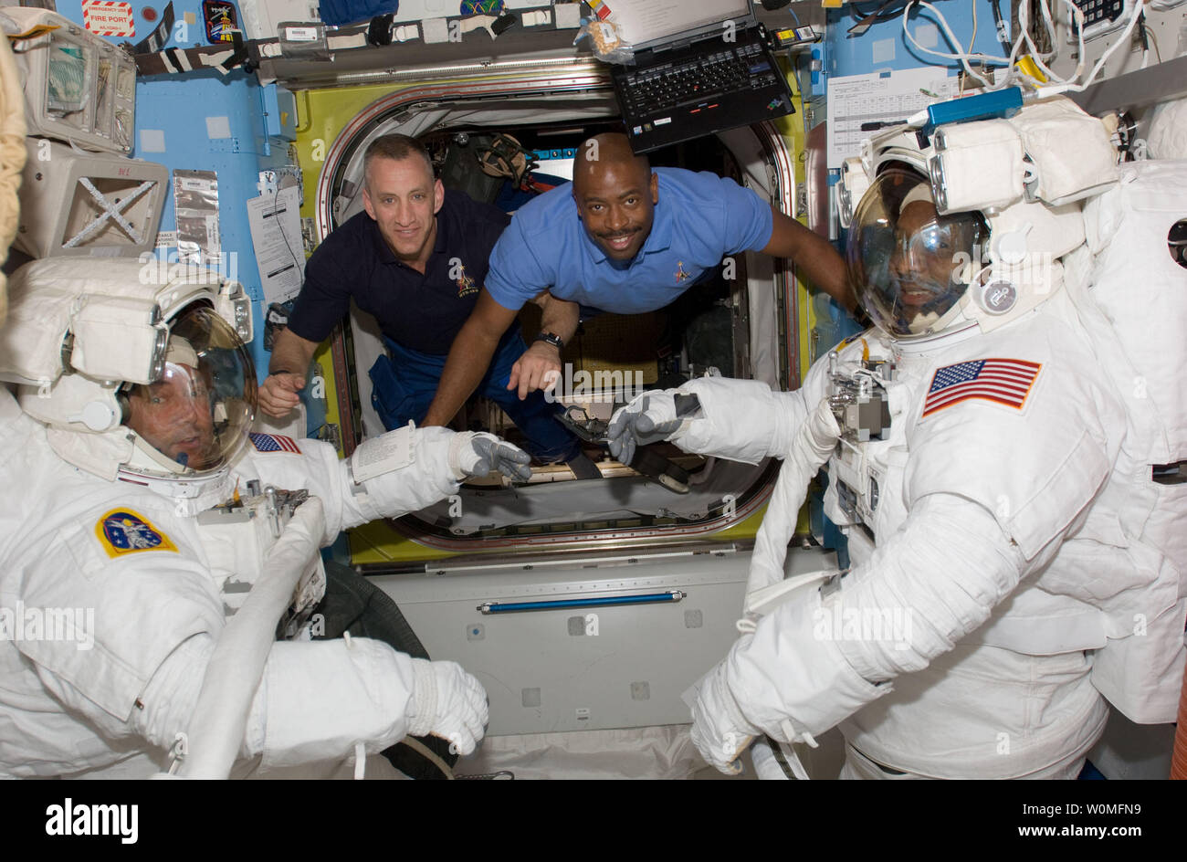 This NASA photo shows astronauts Mike Foreman (left) and Robert L. Satcher Jr. (right), STS-129 mission specialists, as they prepare for their flight day four space walk, as astronauts Charles O. Hobaugh (second left), commander, and Leland Melvin, mission specialist, stay close at hand to assist them, November 19, 2009.   UPI/NASA Stock Photo