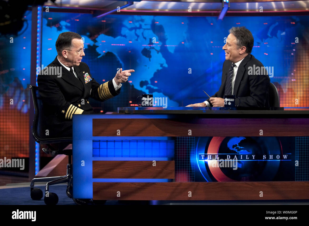 Chairman of the Joint Chiefs of Staff Admiral Mike Mullen (L) appears on The Daily Show with Jon Stewart in New York on January 6, 2010. UPI/Chad J. McNeeley/U.S. Navy Stock Photo