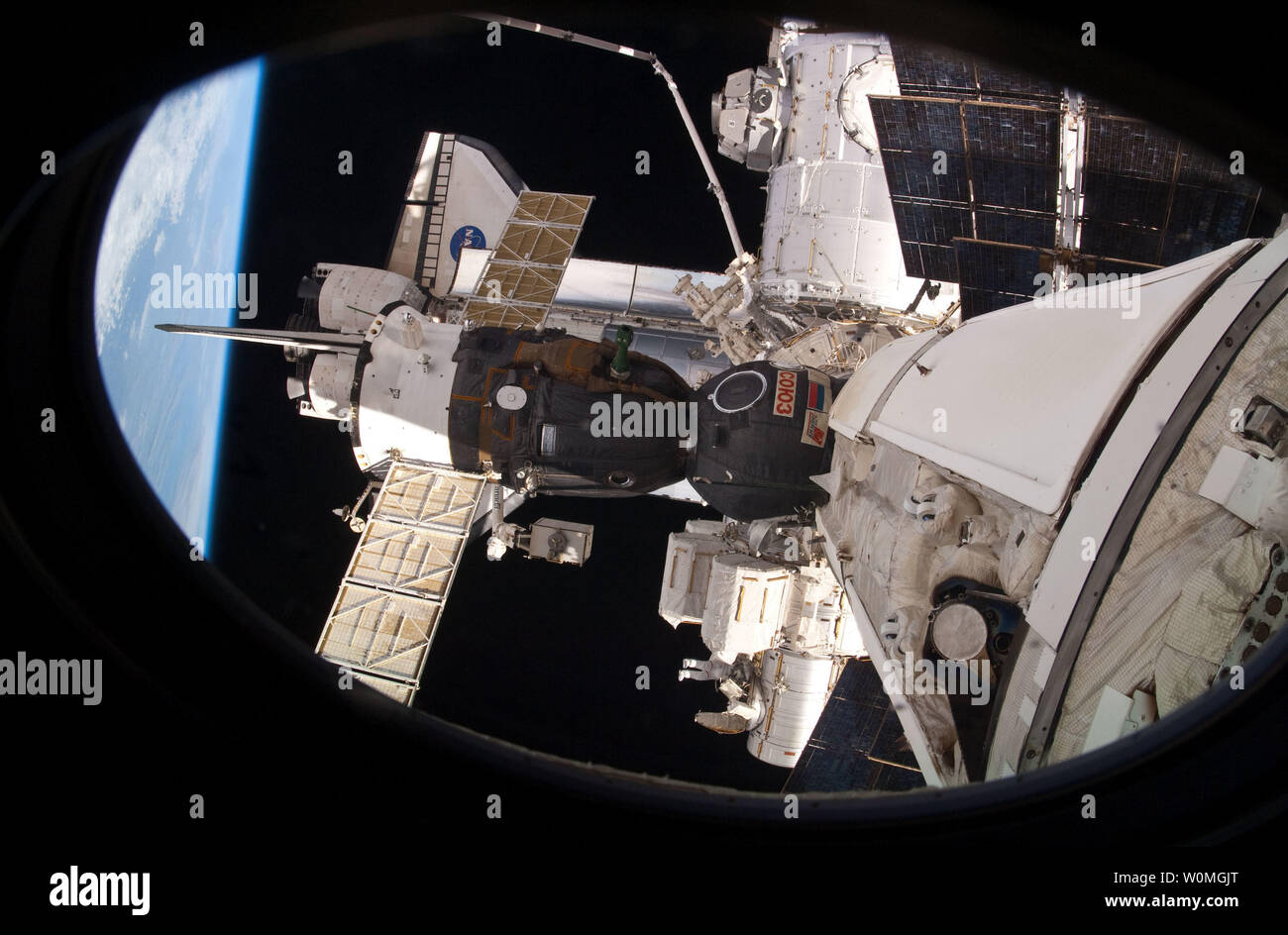 This April 13, 2010 NASA image shows NASA astronaut Rick Mastracchio (bottom center), STS-131 mission specialist, as he works near the Quest airlock during the mission's third and final session of extravehicular activity (EVA) as construction and maintenance continue on the orbital complex. During the six-hour, 24-minute spacewalk, Mastracchio and astronaut Clayton Anderson (out of frame), mission specialist, hooked up fluid lines of the new 1,700-pound tank, retrieved some micrometeoroid shields from the Quest airlock's exterior, relocated a portable foot restraint and prepared cables on the Stock Photo