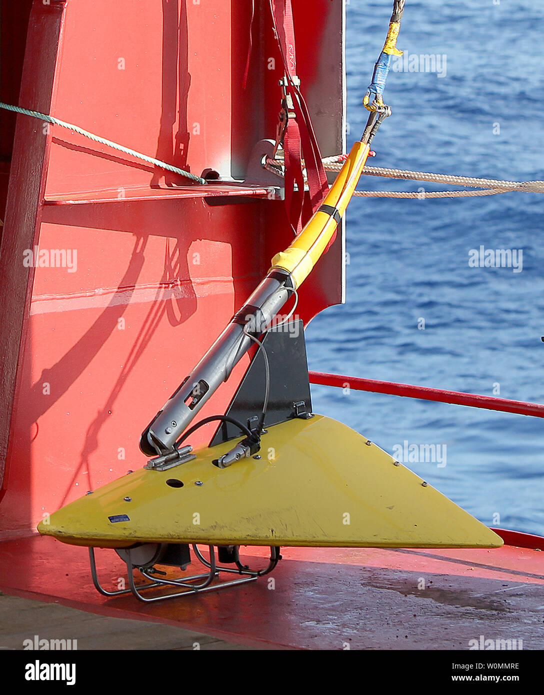 A 'towed pinger locator' is readied to be deployed off the deck of Australian Defense Vessel Ocean Shield in the search for the flight data recorder and cockpit voice recorder of a Malaysia Airlines jetliner missing in the Indian Ocean, about 1,000 miles off the coast of Perth, Australia.  The U.S. Navy 'towed pinger locator' connected to the Ocean Shield picked up signals consistent with that of the missing jetliner it was announced today April 7, 2014.   UPI/Kelly Hunt/Australian Defense Force - Stock Image