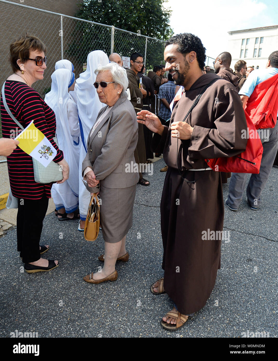 Pilgrims wait in a security line before Pope Francis delivers the delivers Canonization Mass of Blessed Junipero Serra at the Basilica of the National Shrine of the Immaculate Conception, on September 23, 2015, in Washington, DC. The Basilica is the largest Roman Catholic church in the United States. Photo by David Tulis/UPI Stock Photo