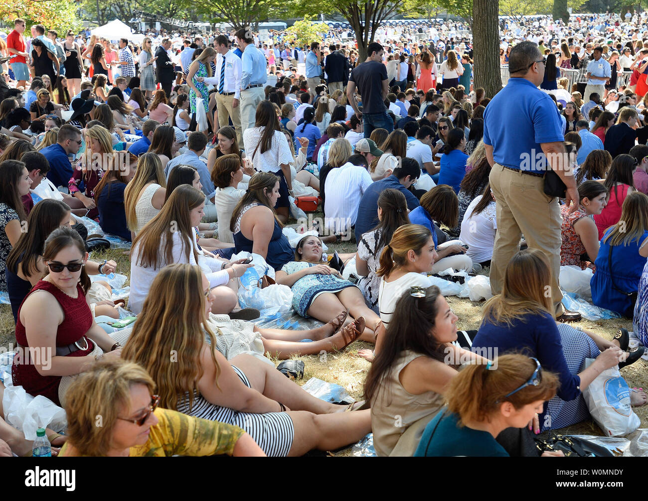 Pilgrims wait on the lawn at the Basilica of the National Shrine of the Immaculate Conception before Pope Francis delivers the Canonization Mass of Blessed Junipero Serra in Washington, D.C., September 23, 2015. The Basilica is the largest Roman Catholic church in the United States. Photo by David Tulis/UPI Stock Photo
