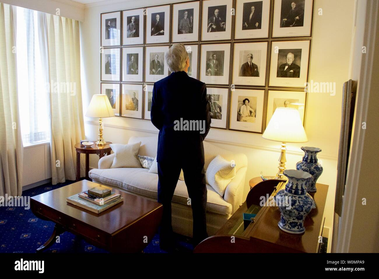 U.S. Secretary of State John Kerry looks at portraits of past U.S. Ambassadors to the Court of St. James while visiting the U.S. Embassy in London, on May 10, 2016, while in the British capital for a series of bilateral meetings, an appearance at Oxford University, and his attendance at an anti-corruption meeting hosted by British Prime Minister David Cameron. Photo by U.S. Department of State/UPI - Stock Image