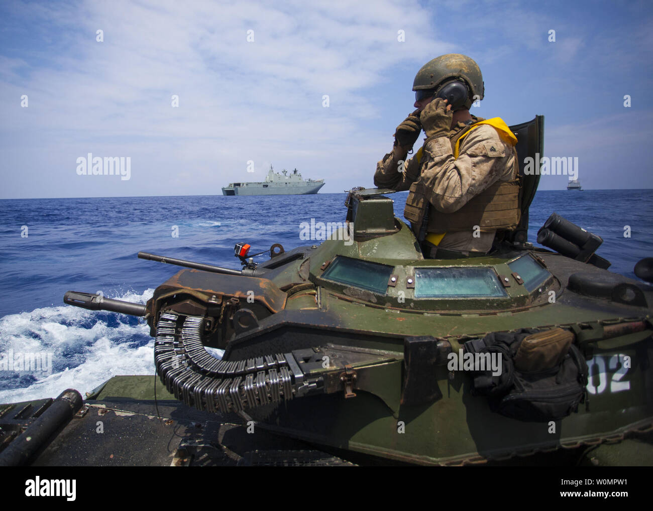 Cpl. Ryan Dills communicates with other assault amphibious vehicles while traveling from amphibious assault ship USS San Diego to Royal Australian Navy Canberra class amphibious ship HMAS Canberra (L02) in the Pacific Ocean, on July, 18 2016. The Marines are participating in Rim of the Pacific (RIMPAC) 2016, a multinational military exercise, from June 29 to August 4 in and around the Hawaiian Islands. Photo by Christopher Giannetti/U.S. Marine Corps/UPI Stock Photo