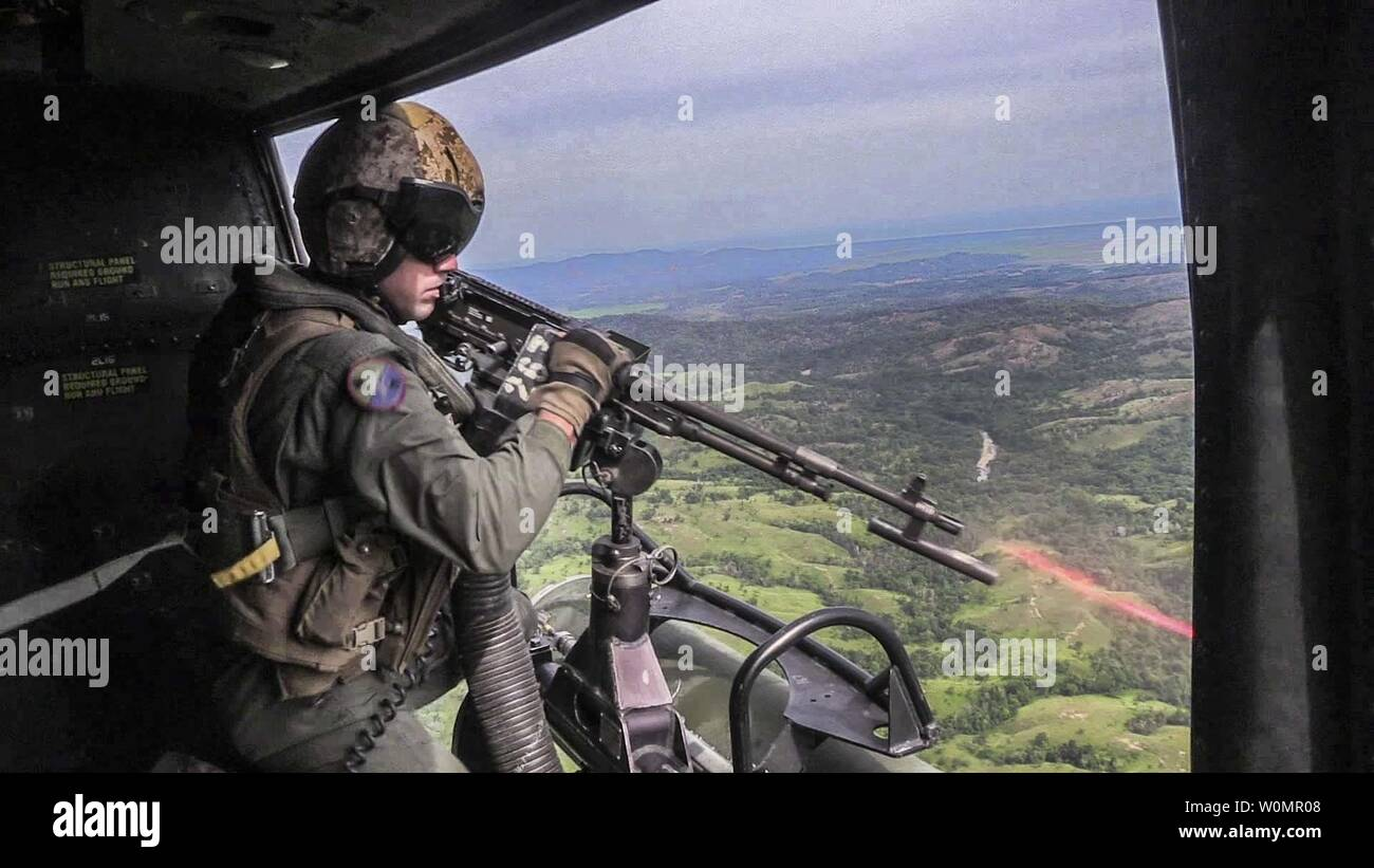 U.S. Marine Corporal William F. McNamara, a crew chief with the 13th Marine Expeditionary Unit, fires an M240B medium machine gun on range targets during joint close air support exercise between the Malaysian Royal Air Force and Marines from the 13th MEU, on August 7,  2016. The 13th MEU, embarked on the Boxer Amphibious Ready Group, is operating in the U.S. 7th Fleet area of operations in support of security and stability in the Indo-Asia-Pacific region. Photo by Alvin Pujols/U.S. Marine Corps/UPI Stock Photo