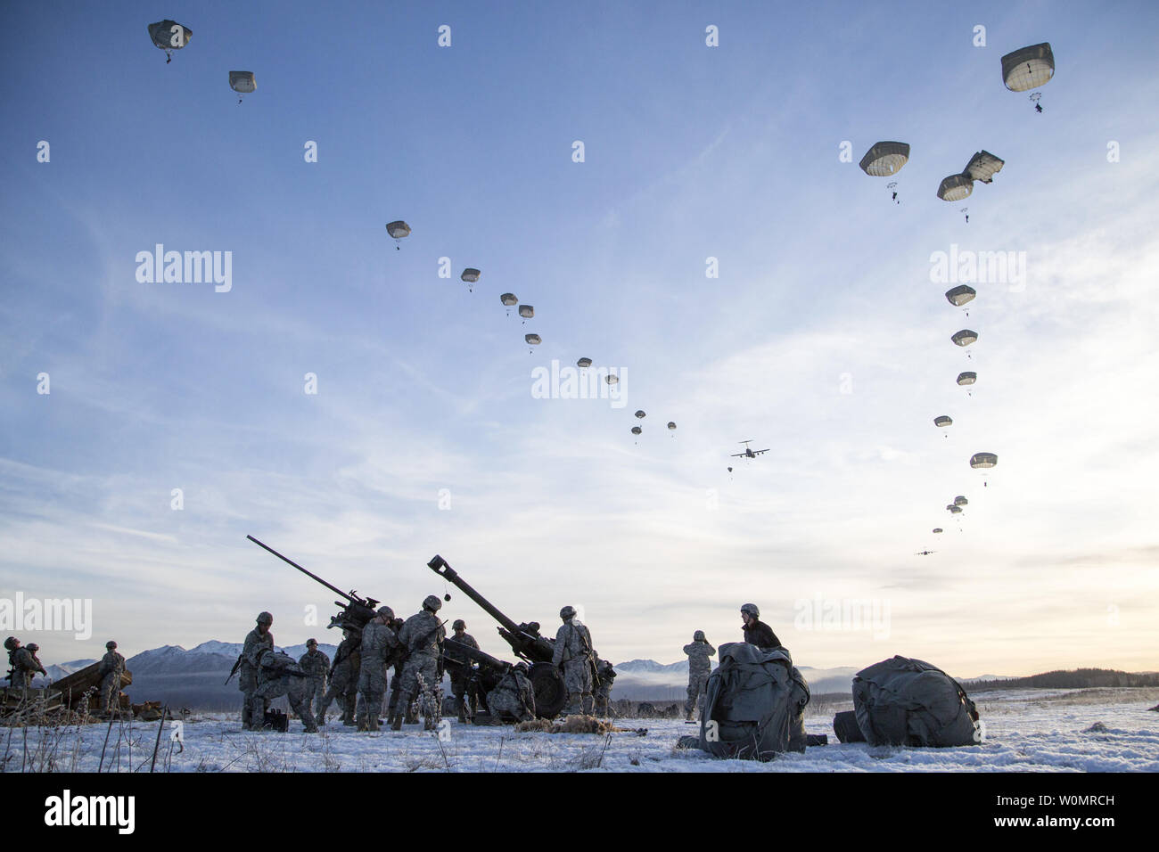 Paratroopers assigned to A Battery, 2nd Battalion, 377th Parachute Field Artillery Regiment, 4th Infantry Brigade Combat Team (Airborne), 25th Infantry Division, U.S. Army Alaska, descend over Malemute drop zone while conducting airborne and live fire training at Joint Base Elmendorf-Richardson, Alaska, November 22, 2016. Photo by Alejandro Pena/U.S. Air Force/UPI Stock Photo