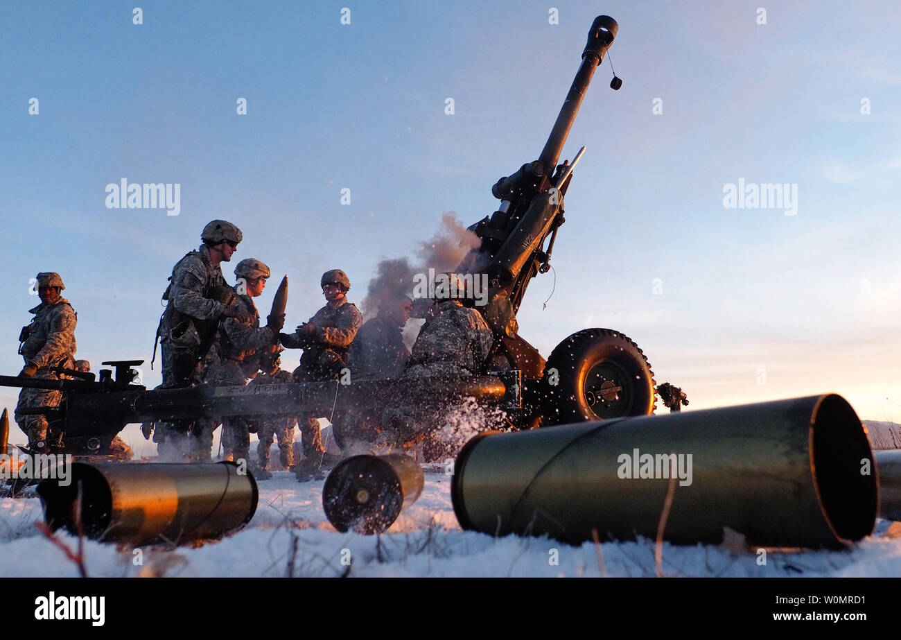 Paratroopers assigned to Alpha Battery, 2nd Battalion, 377th Parachute Field Artillery Regiment, 4th Infantry Brigade Combat Team (Airborne), 25th Infantry Division, U.S. Army Alaska, reload a M119A2 105mm howitzer during a live fire on Malemute drop zone at Joint Base Elmendorf-Richardson, Alaska, November 22, 2016. USARAK is home to the ArmyÕs only Pacific airborne brigade combat team, and maintains the only airborne rapid-response capacity within the Pacific Command Area of Responsibility. Photo by Justin Connaher/U.S. Air Force/UPI Stock Photo