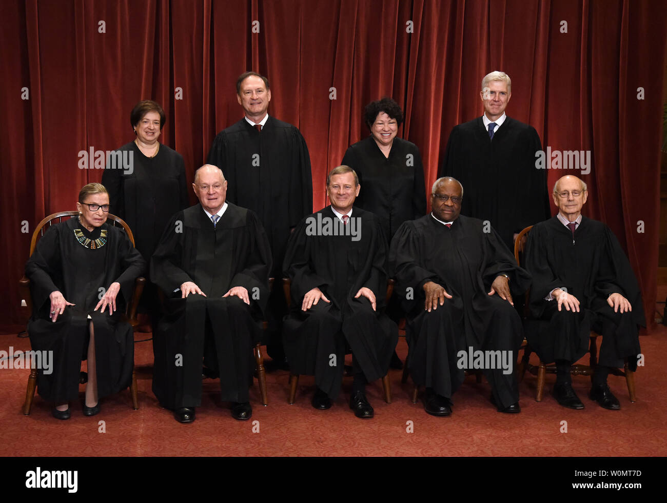 Members of the U.S. Supreme Court pose for a group photograph at the Supreme Court building in Washington, DC on June 1 2017. Front row. Seated from left, Associate Justice Ruth Bader Ginsburg, Associate Justice Anthony M. Kennedy, Chief Justice of the United States John G. Roberts, Associate Justice Clarence Thomas, and Associate Justice Stephen Breyer.  Standing behind from left, Associate Justice Elena Kagan, Associate Justice Samuel Alito Jr., Associate Justice Sonia Sotomayor, and Associate Justice Neil Gorsuch.    Photo by Olivier Douliery/UPI - Stock Image