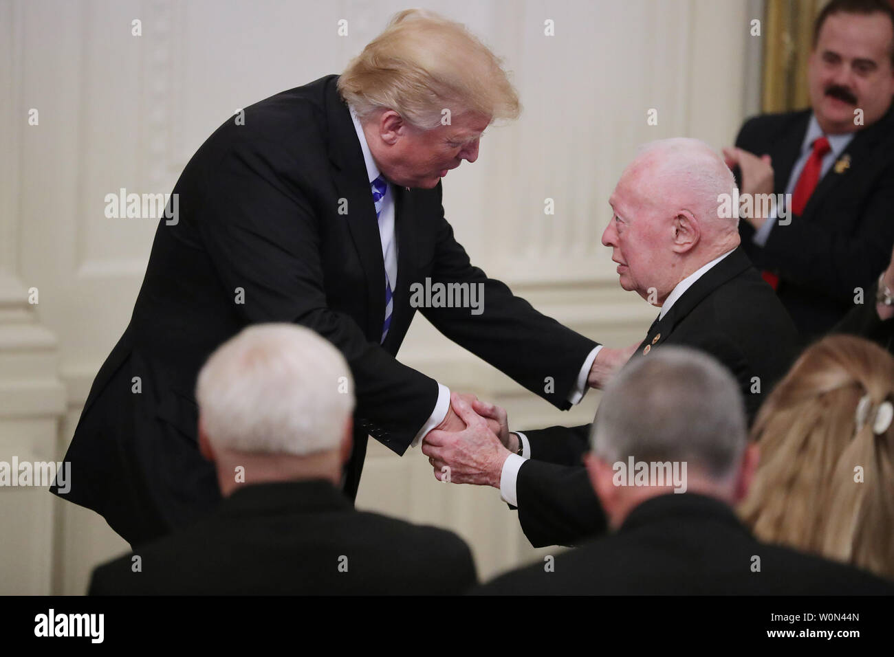 U.S. President Donald Trump shakes hands with former Commandant of the Marine Corps retired Gen. Alfred Gray while commemorating the 35th anniversary of attack on the Beirut Barracks in the East Room of the White House October 25, 2018 in Washington, DC. On October 23, 1983 two truck bombs struck the buildings housing Multinational Force in Lebanon (MNF) peacekeepers, killing 241 U.S. and 58 French peacekeepers and 6 civilians.     Photo by Chip Somodevilla/UPI Stock Photo