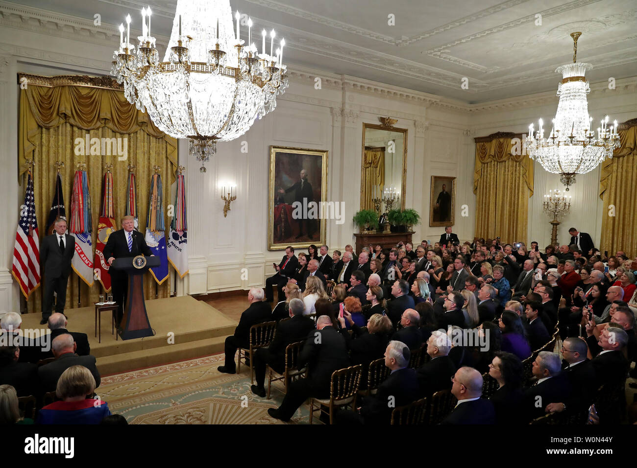 President Donald Trump hosts a reception commemorating the 35th anniversary of attack on the Beirut Barracks with Secretary of Defense James Mattis (L) in the East Room of the White House October 25, 2018 in Washington, DC. On October 23, 1983 two truck bombs struck the buildings housing Multinational Force in Lebanon (MNF) peacekeepers, killing 241 U.S. and 58 French peacekeepers and 6 civilians.   Photo by Chip Somodevilla/UPI Stock Photo