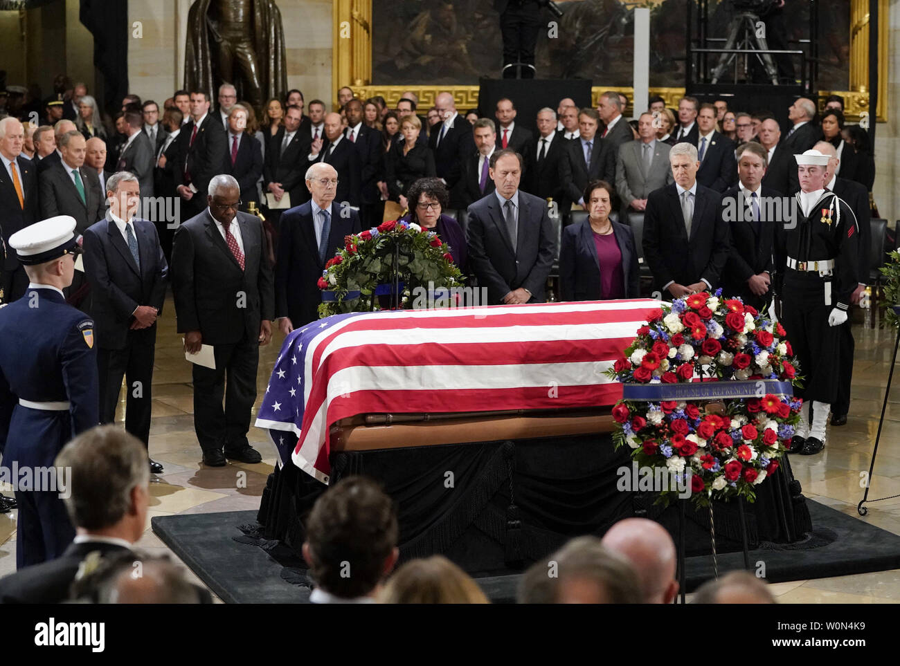 Members of the Supreme Court pause in front of the flag-draped casket of former President George H.W. Bush lying in state at the U.S. Capitol Rotunda in Washington, Monday, 3, 2018. From l-r., are Chief Justice John Roberts, Associate Justice Clarence Thomas, Associate Justice Stephen Breyer, Associate Justice Sonia Sotomayor, Associate Justice Samuel Alito, Associate Justice Elena Kagan, Associate Justice Neil Gorsuch, and Associate Justice Brett Kavanaugh. Photo by Pablo Martinez Monsivais/UPI - Stock Image