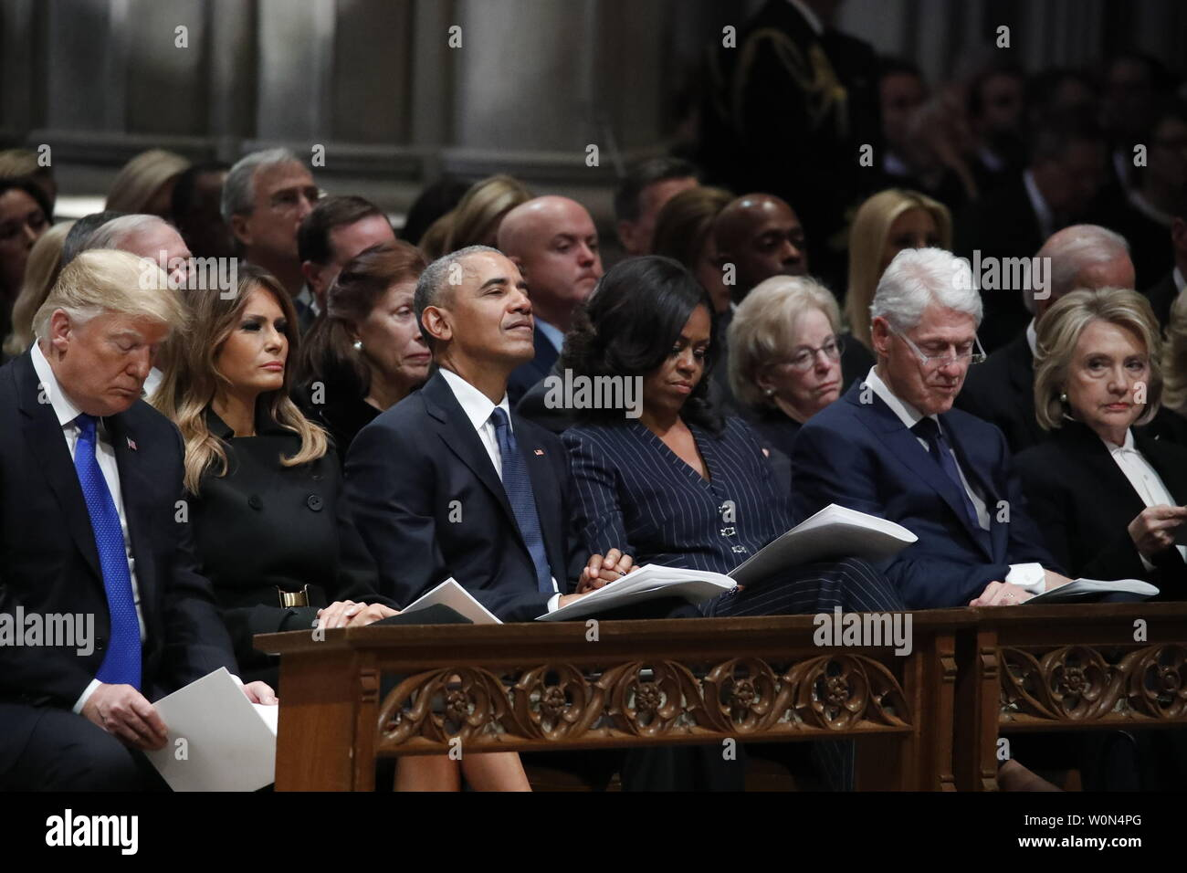 From left, President Donald Trump, first lady Melania Trump, former President Barack Obama, Michelle Obama, and former President Bill Clinton listen during a State Funeral at the National Cathedral, Wednesday, Dec. 5, 2018, in Washington, DC for former President George H.W. Bush.      Photo by Alex Brandon/UPI Stock Photo