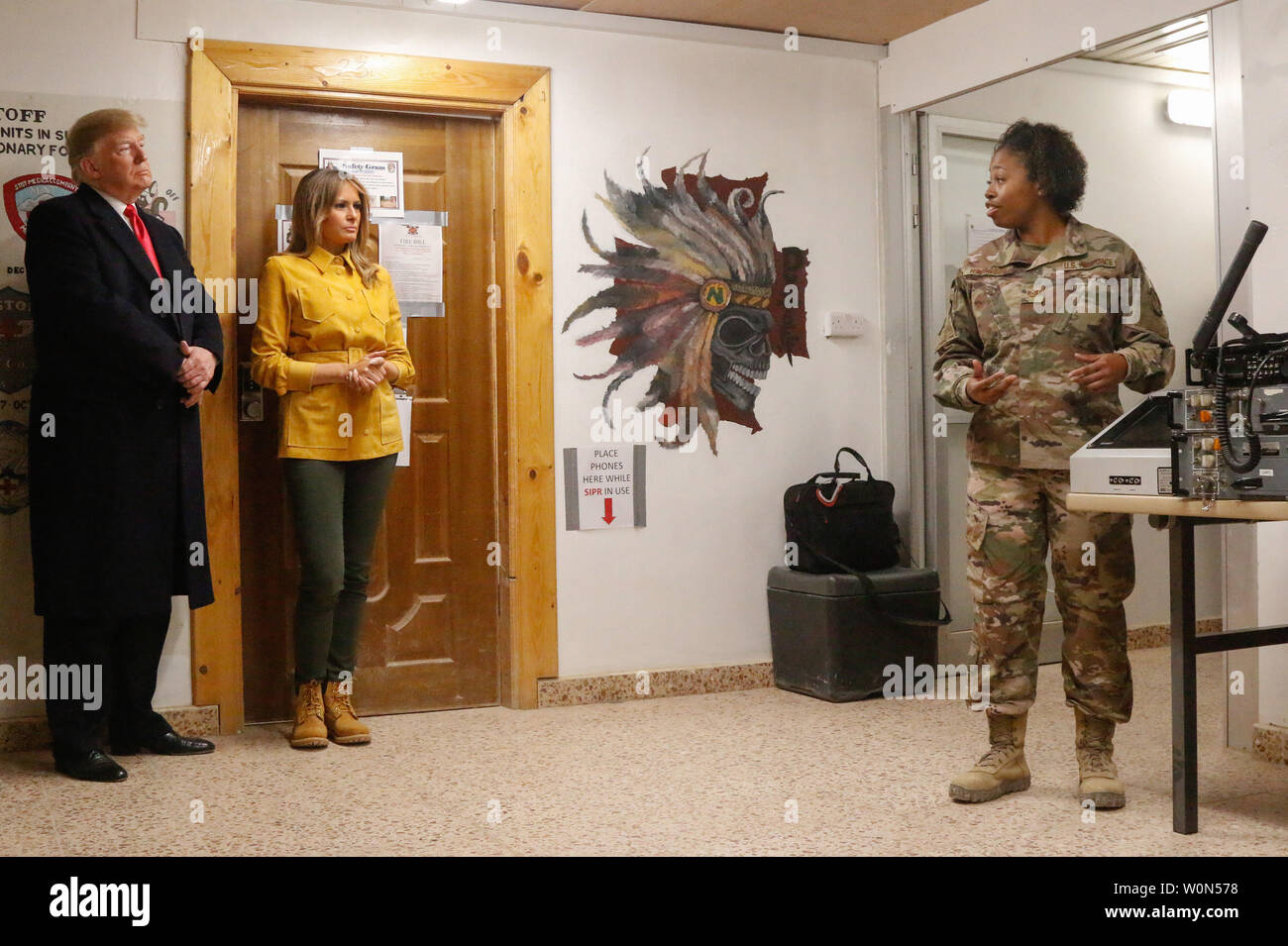 U.S. Air Force Tech. Sgt. Arlandrea Hairston, airfield systems technician assigned to Combined Joint Task Force - Operation Inherent Resolve (CJTF-OIR), explains commonly used airfield technology to U.S. President Donald J. Trump and first lady Melania Trump during their troop visit to Al Asad Air Base, Iraq, December 26, 2018. CJTF-OIR works by, with, and through partner forces to defeat ISIS. Photo by 1st Lt. Leland White/U.S. Army National Guard/UPI Stock Photo