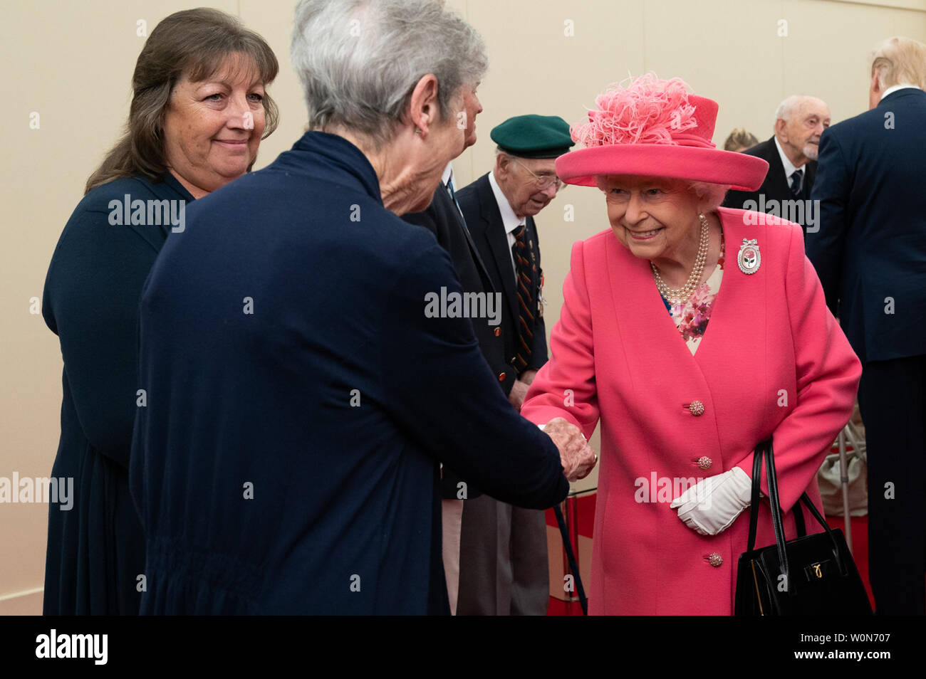 Britain's Queen Elizabeth II, joined by President Donald J. Trump, meets with World War II veterans and their families during a D-Day National Commemorative Event on June 5, 2019, at the Southsea Common in Portsmouth, England. White House Photo by Andrea Hanks/UPI Stock Photo
