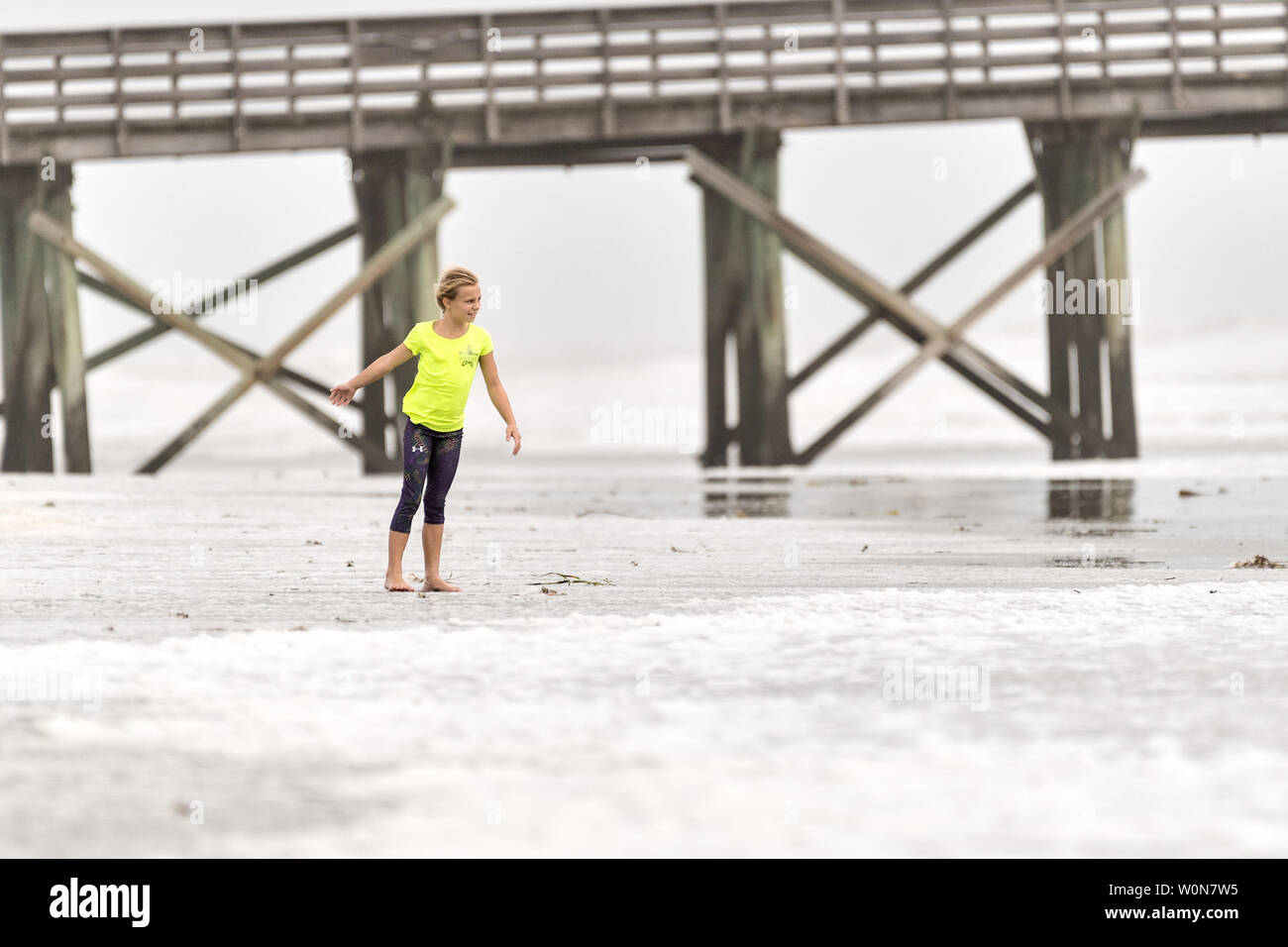 A young girl struggles to walk along the beach in high winds along the coast from Tropical Storm Hermine in Isle of Palms, South Carolina, on September 2, 2016. Beach goers were discouraged from entering the water due to rip currents, turbulent waves and winds exceeding 50-mph.     Photo by Richard Ellis/UPI Stock Photo