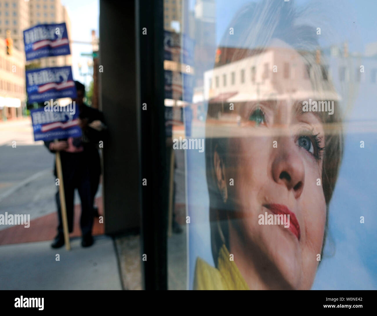 A man holds signs showing support for Democratic presidential candidate Sen. Hillary Clinton (D-NY) outside of the Clinton headquarters in Charleston, West Virginia on May 13, 2008. West Virginians head to the polls today as they vote in that states Presidential primaries. (UPI Photo/Kevin Dietsch) Stock Photo