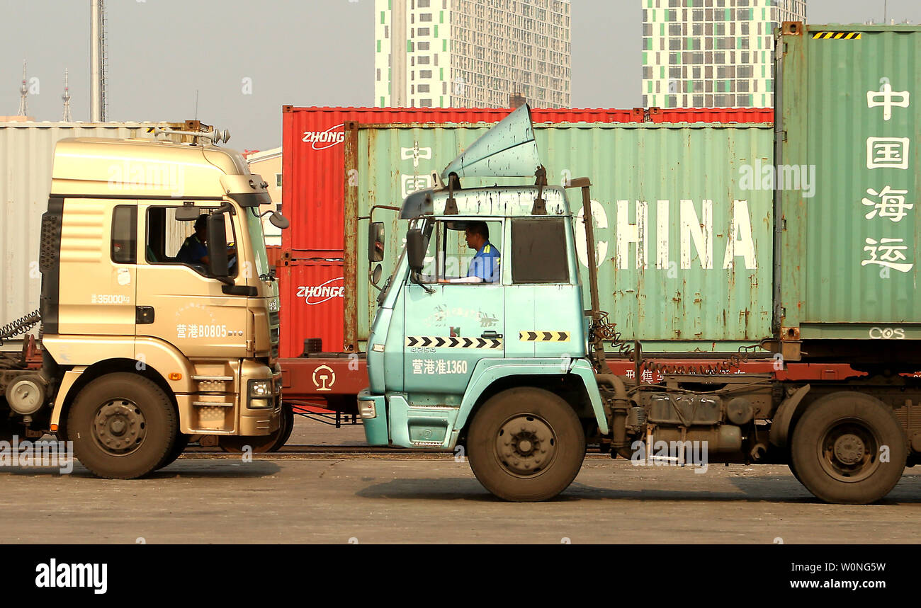 Chinese truck drivers transport cargo containers to a port in Yingkou, a major port city in Liaoning Province, on July 18, 2018.  China's Ministry of Commerce is pursuing a legal remedy with the World Trade Organization (WTO) against the U.S. over new tariffs on $200 billion worth of Chinese exports.     Photo by Stephen Shaver/UPI - Stock Image
