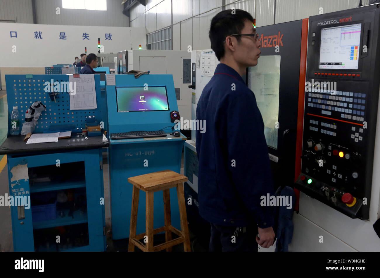 A Chinese engineer monitors the precise drilling of aviation