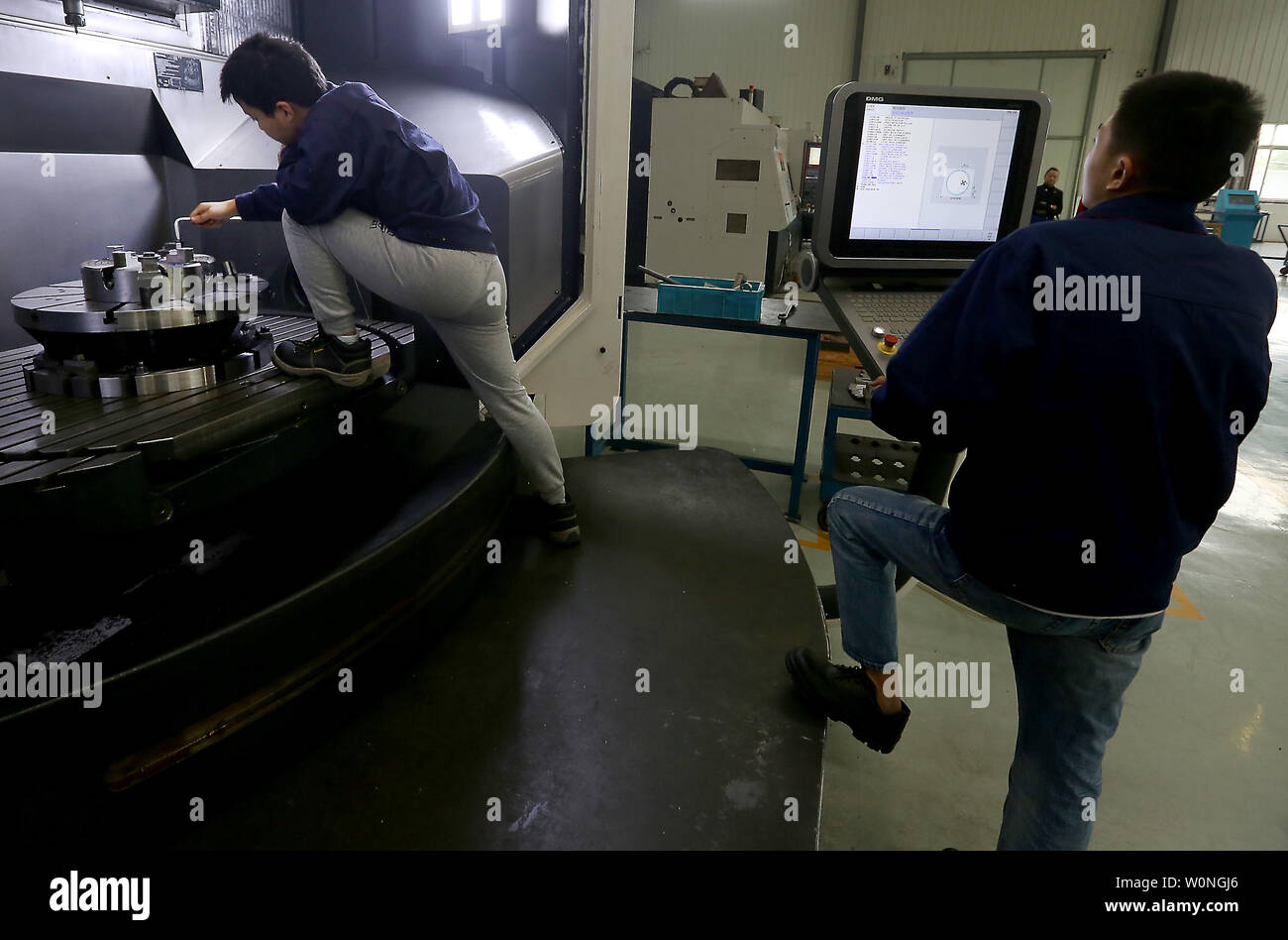 Chinese engineers monitor the precise drilling of aviation