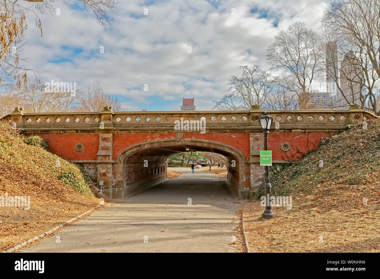 NEW YORK, USA - JANUARY 15, 2018: Red brick Driprock Arch bridge in Central Park winter season. - Stock Image