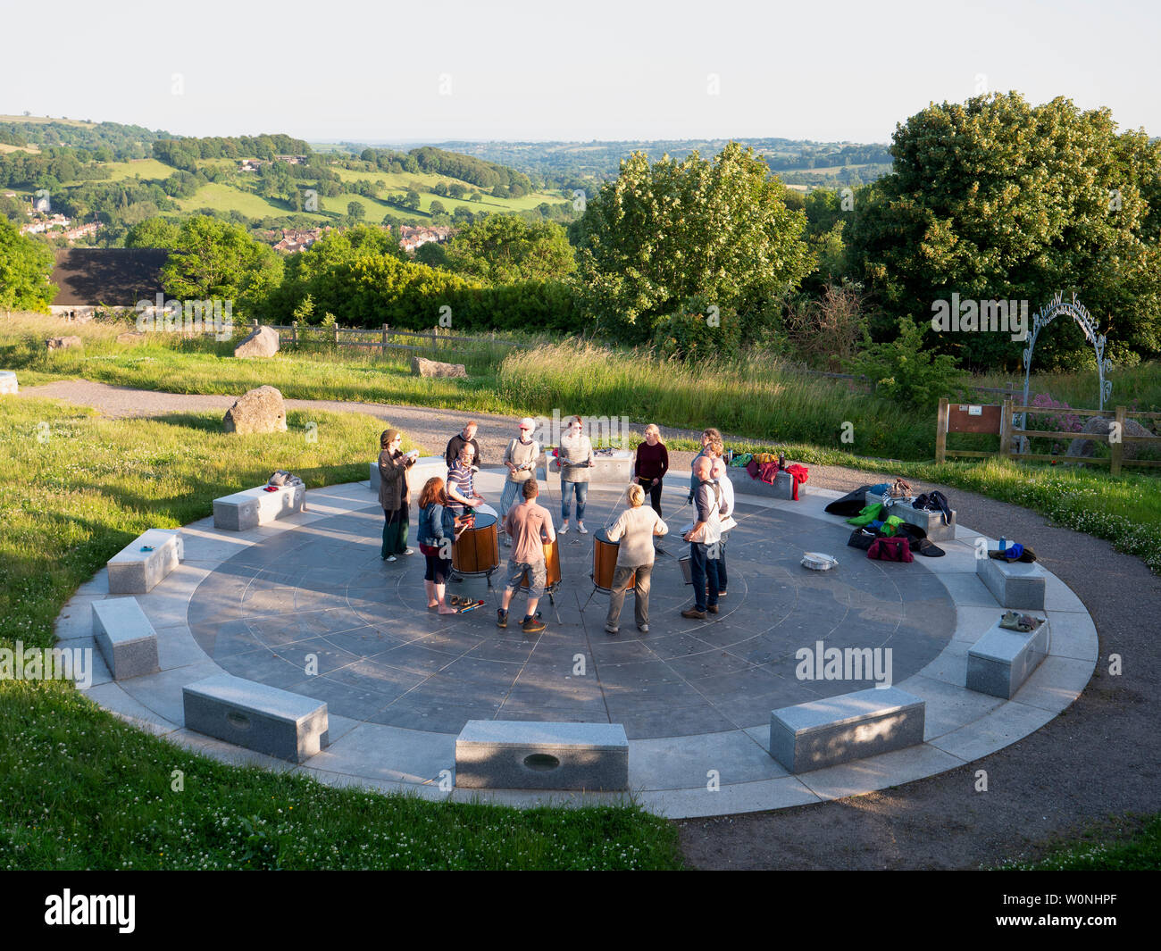 UK Weather news: group of drummers playing and enjoying the end of a sunny warm day at the star disc above Wirksworth in the Derbyshire Dales, Peak District National Park Stock Photo
