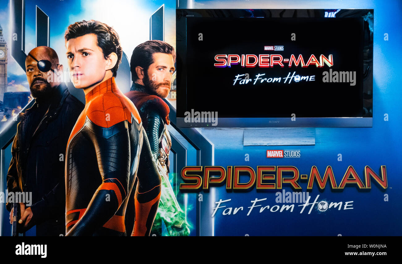 "Bangkok, Thailand - Jun 26, 2019: Marvel's ""Spider-Man: Far From Home"" backdrop poster with Sony TV show movie trailer in theatre. Cinema promotional Stock Photo"