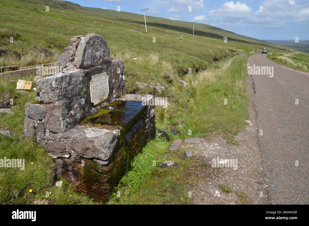 A well by the side of the A 838 road in the Scottish Highlands, part of the North Coast 500 tourist route. - Stock Image