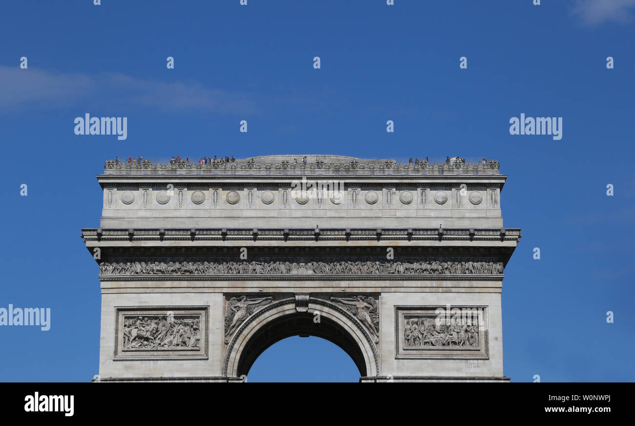 people standing atop the arc de triomphe in Paris France Stock Photo
