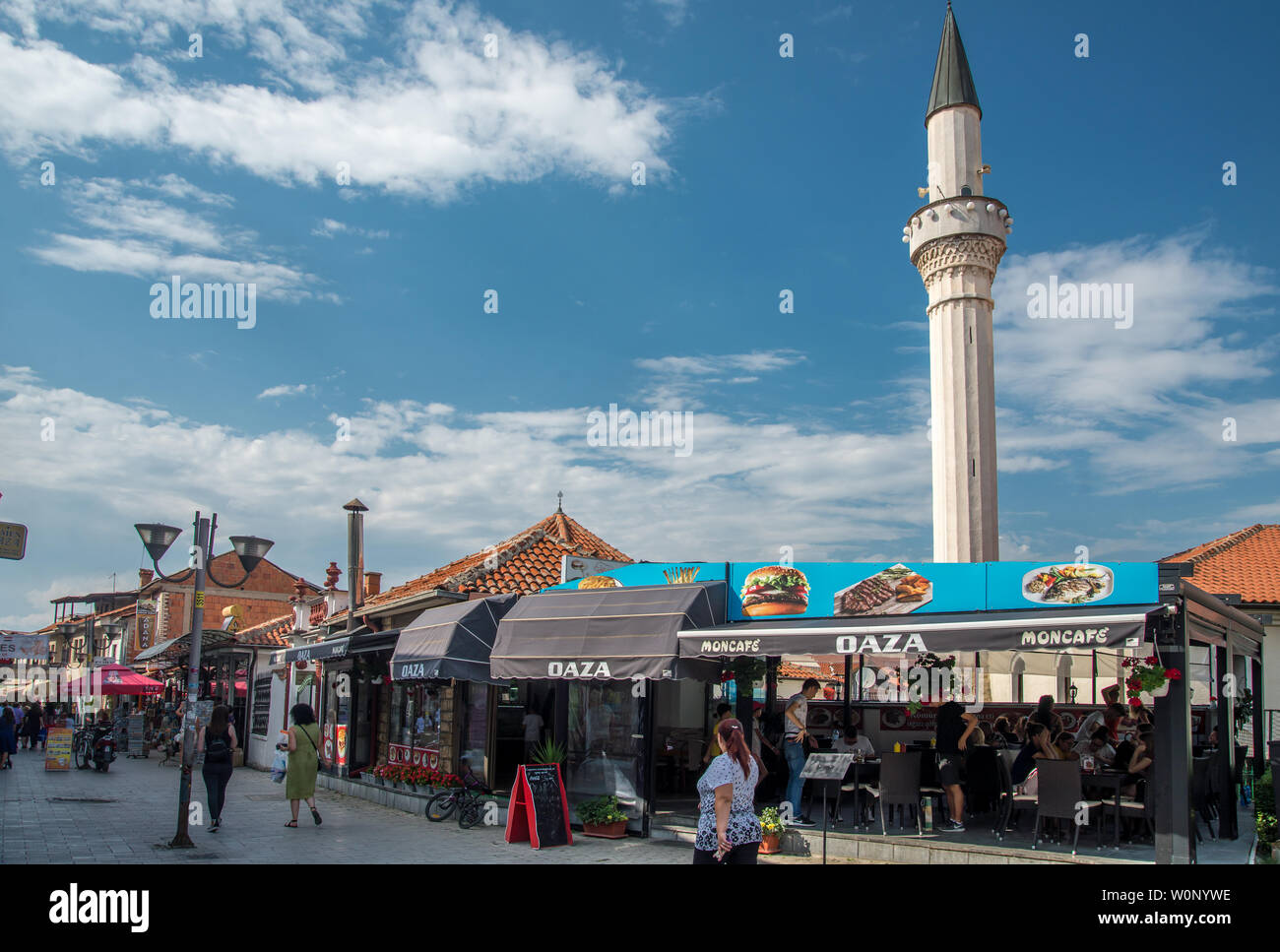 OHRID,MACEDONIA-AUGUST 31,2018:Fast food eaterie at Piazza della Fontana featuring the Ali Pasha Mosque, Cami - Stock Image