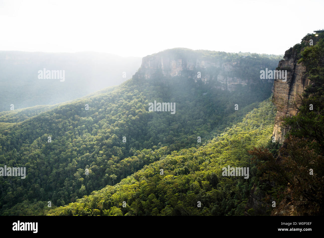 Sunrays over the Blue mountains at three sisters rock formation during sunset, Katoomba, New South Wales, Australia Stock Photo