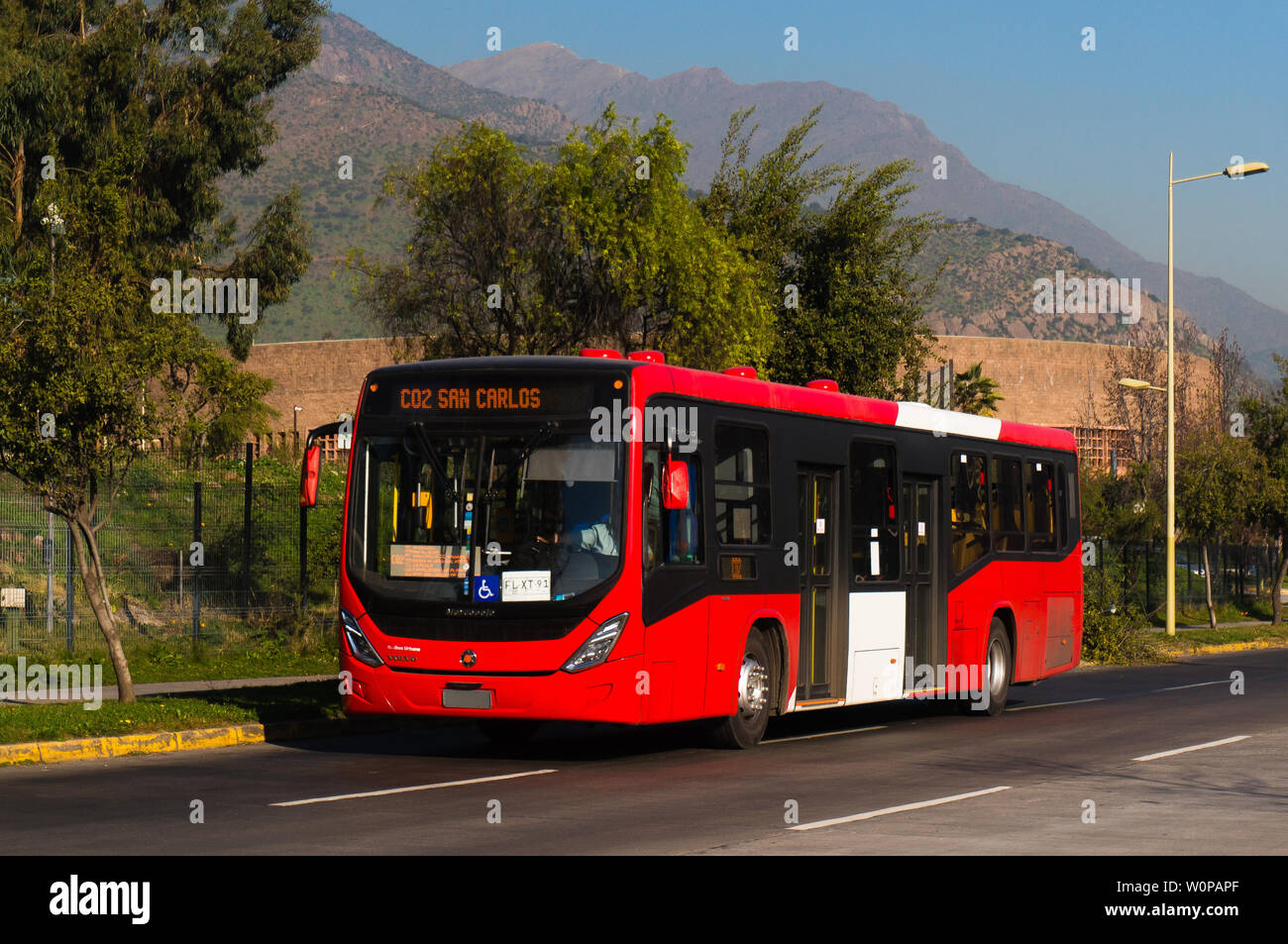 SANTIAGO, CHILE - JULY 2017: A Transantiago bus during a sunset in Santiago - Stock Image
