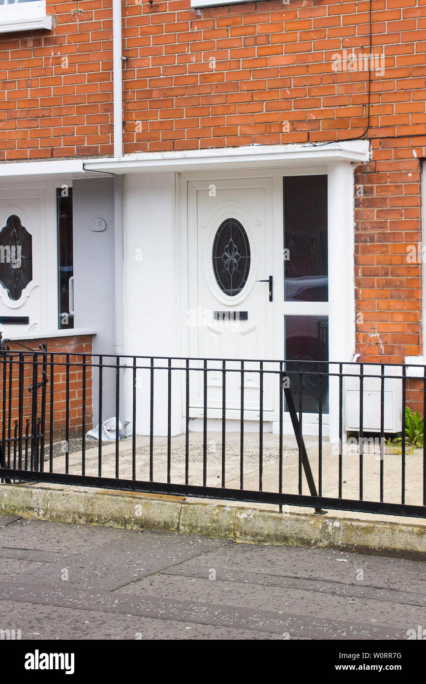 An example of a well maintained mid terrace house built in Belfast in the 1950's as part of the post war social housing development. - Stock Image