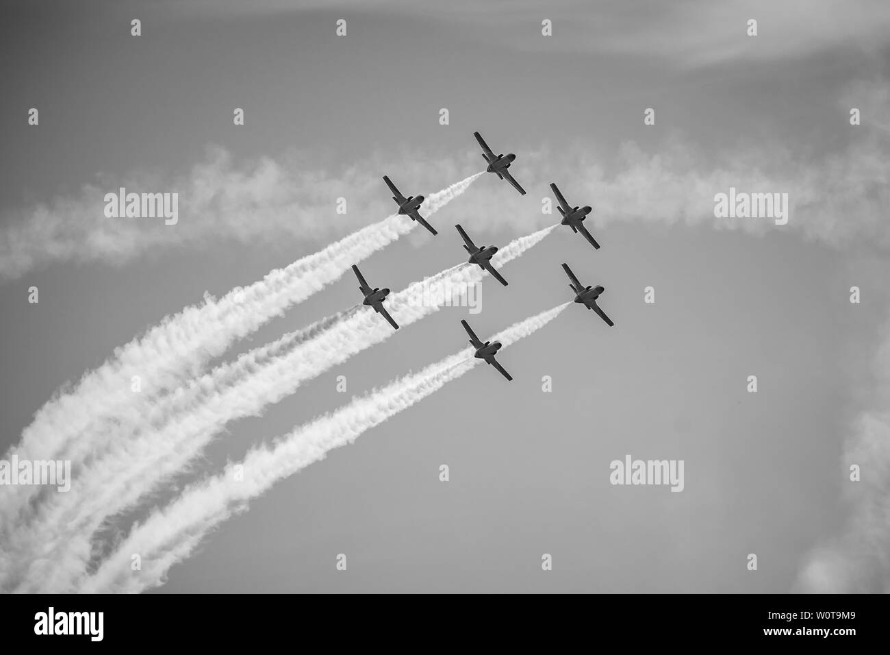BERLIN, GERMANY - APRIL 28, 2018: Demonstration flight by the aerobatic team Patrulla Aguila (Eagle Patrol). Black and white. Exhibition ILA Berlin Air Show 2018. - Stock Image