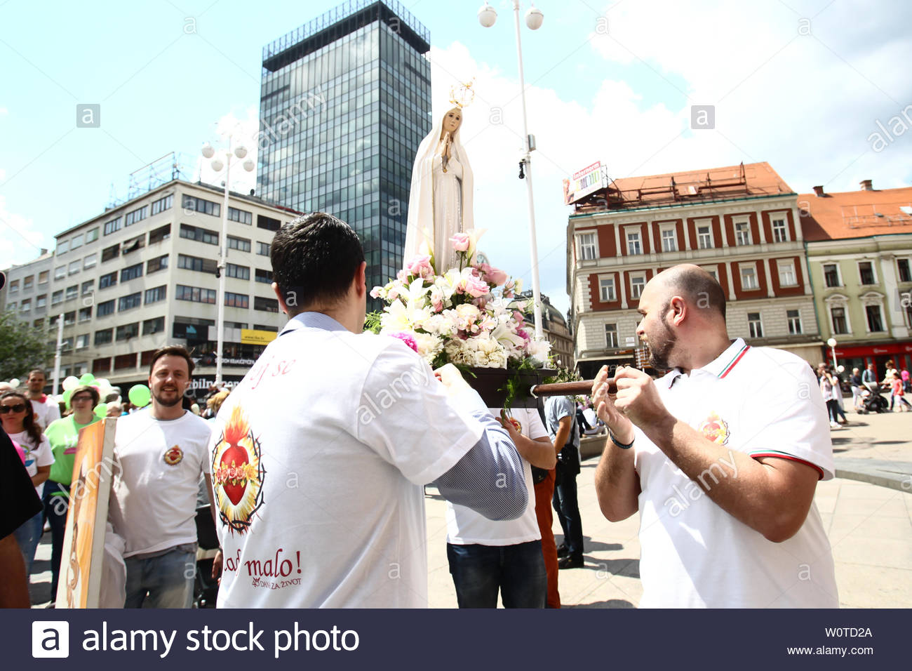 ZAGREB,CROATIA - MAY 19, 2018 : People carrying a Virgin Mary statue while marching against abortions and in support of every child under name March for life in city center in Zagreb, Croatia. Stock Photo