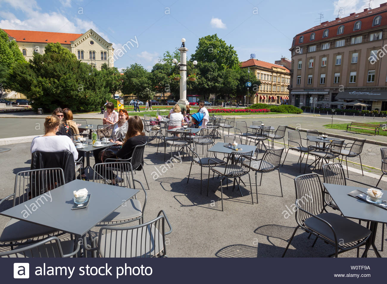 ZAGREB, CROATIA - MAY 19, 2018 : People sitting on the coffee bar terrace of Croatian National Theater in Zagreb, Croatia. Stock Photo
