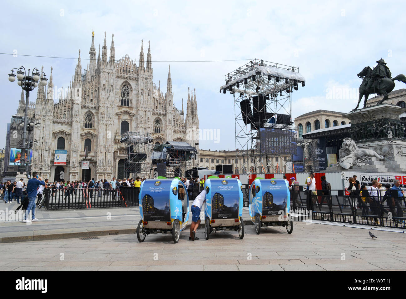 "Milan/Italy - June 9, 2016: Modern rickshaws parked at the Duomo square during ""Radio Italia live al concerto"" event at piazza Duomo. Stock Photo"